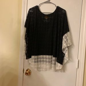 Poncho style top with black tank